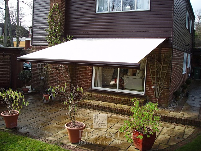Installing awnings for houses having cladding