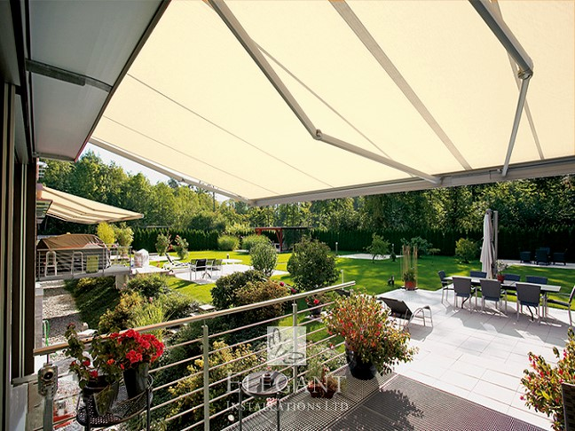 Quad arm retractable awning